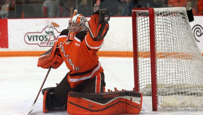 Chris Nell makes a glove save during his sophomore season at Bowling Green State University. The former Green Bay Notre Dame goalie participated in the NHL development camp of the Toronto Maple Leafs  this month.
