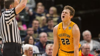 Morristown High School junior guard Logan Laster (22) reacts to knocking down a three-point basket during the first half of the IHSAA Boys' Basketball Class A State Finals game against Southwood High School at Bankers Life Fieldhouse, Saturday, March 24, 2018.