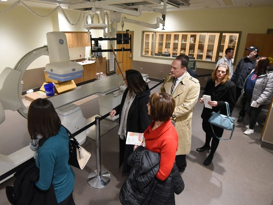 Visitors touring the new Avita Health System in Ontario get a close look at the Cath Lab on Thursday.