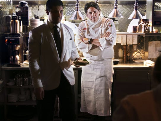 Bacco Ristorante owner Luciano Del Signore stands at the chef's station of his Southfield restaurant.