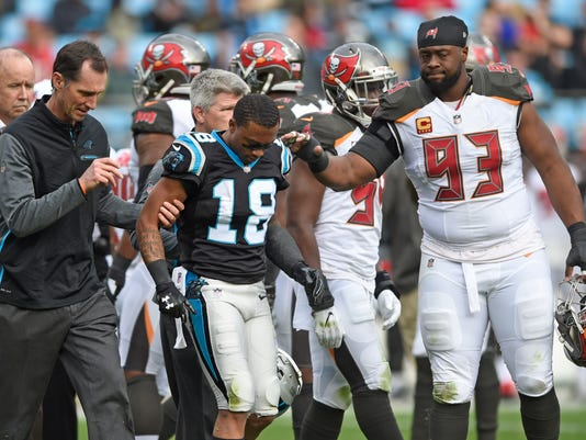 Carolina Panthers' Damiere Byrd (18) is consoled by Tampa Bay Buccaneers' Gerald McCoy (93) as he is helped off the field after being injured during the second half of an NFL football game in Charlotte, N.C., Sunday, Dec. 24, 2017. (AP Photo/Mike McCarn)