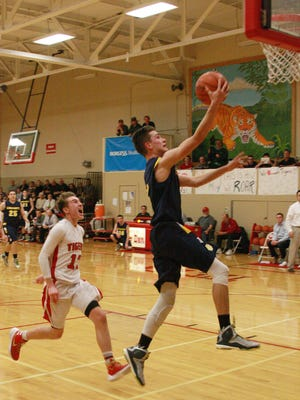 Climax-Scotts senior Zach Harris goes up for a break-away layup against St. Philip on Friday.