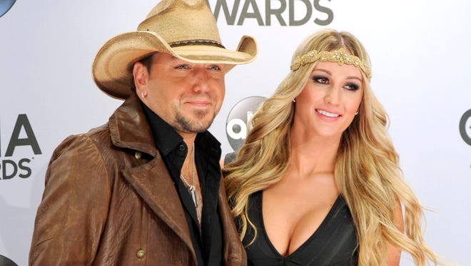 In this Nov. 5, 2014 file photo, Jason Aldean, left, and Brittany Kerr arrive at the 48th annual CMA Awards at the Bridgestone Arena in Nashville, Tenn.