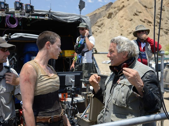Charlize Theron and George Miller on the set of 'Mad