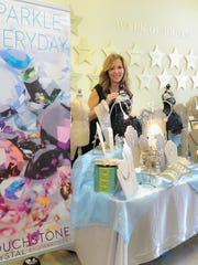Laura D'Urso sells Touchstone Crystal by Swarovski jewelry at the Phoenix Productions Holiday Bazaar in Red Bank.