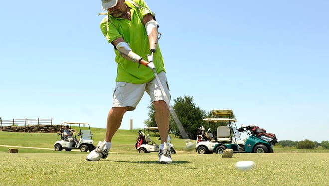 Steve Gandy, from Van, tees off on the eighth hole during a practice round for the Southwest Amputee Golf Association 2017 Regional Championships on Friday, June 23, 2017, at the Hideout Gold Club at Lake Brownwood. Gandy, who lost both his hands in a work accident more than 40 years ago, uses specially made prosthetics that he hooks his golf club into to play.