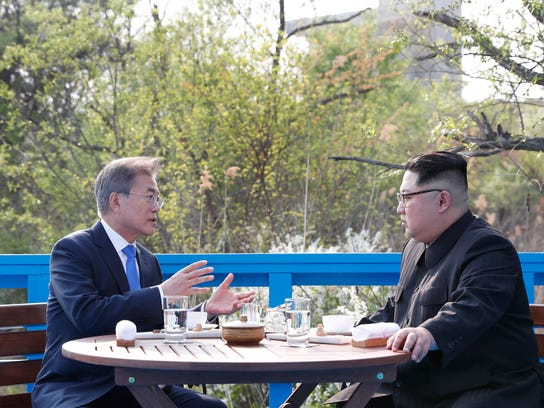In this April 27, 2018 photo, North Korean leader Kim Jong Un, right, and South Korean President Moon Jae-in, left, talk at a footbridge at the border village of Panmunjom in the Demilitarized Zone, South Korea. North Korean leader Kim Jong Un and South Korean President Moon Jae-in have met on Saturday, May 26, 2018 for the second time in a month to discuss peace commitments they reached in their first summit and Kim's potential meeting with President Donald Trump. (Korea Summit Press Pool via AP)
