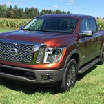 A step extends from the 2017 Nissan Titan's rear bumper for easy access to the truck bed.