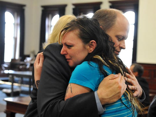 Kristy Perez hugs county attorney John Parker after Perez's ex-boyfriend, David Hyslop, was found guilty of deliberate homicide in the June 2011 death of her 2-year-old daughter October Perez. A law passed a preliminary vote in the state House on Tuesday that would establish a Child Abuse and Fatality Review Commission to take a close look at cases such as Perez's death.