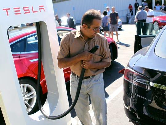 Ninad Huilgol plugs his Model S into one of Tesla Motors'