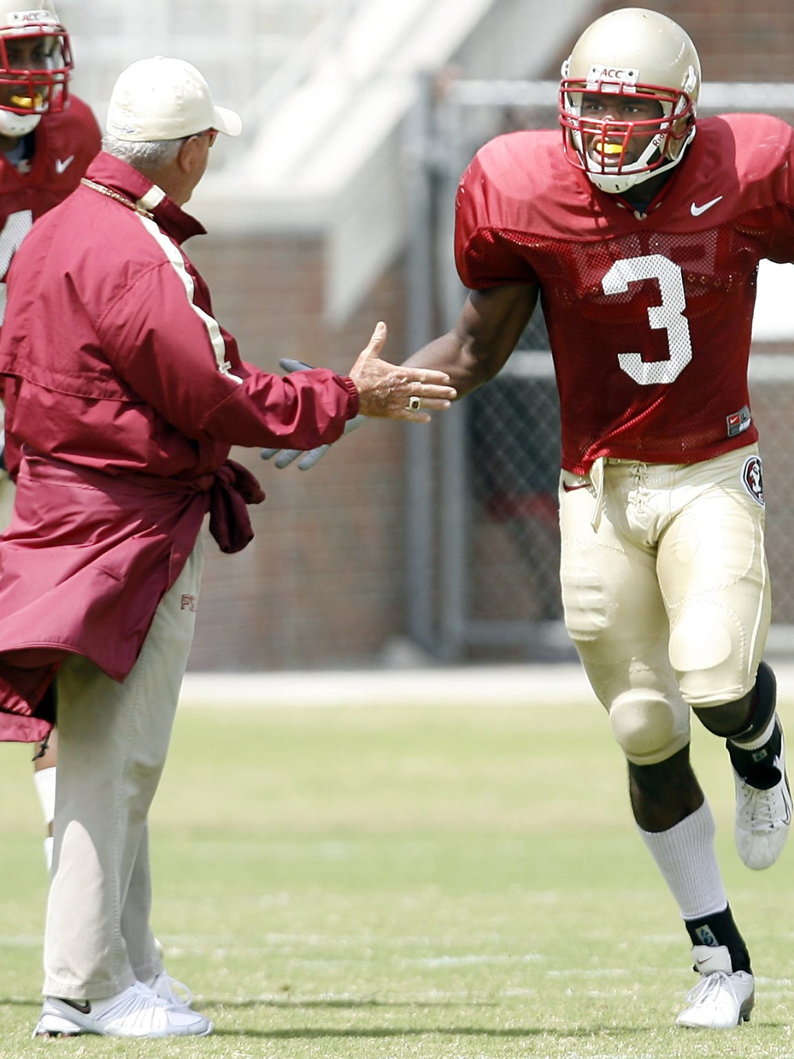 Myron Rolle gives a high five to former FSU coaching