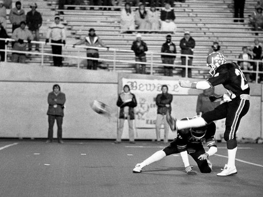 Overton High kicker Mark Morrison (24) is kicking a 29-yard field goal in the second quarter that held up for a 3-0 win over Rhea County High in the TSSAA Class state title game at VanderbiltÕs Dudley Field Dec. 4, 1981.