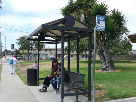 Waiting for Bus 41 at the Cesar Chavez Library in Salinas.