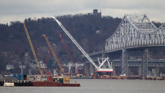 The Tappan Zee Bridge, seen Dec. 17, as its replacement rises in the Hudson. The new $3.9 billion span will be paid off with toll revenue, according to the New York State Thruway.