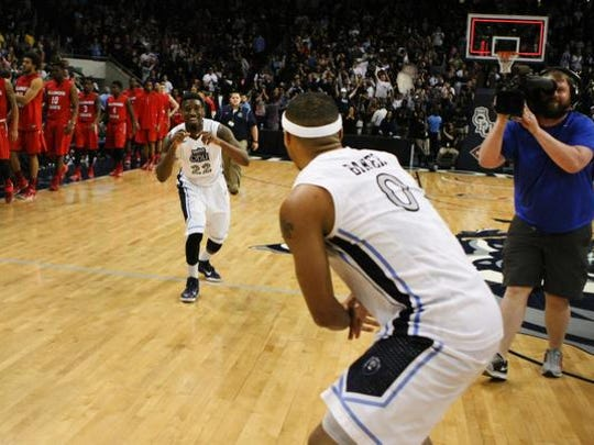 Old Dominion's Ambrose Mosley (22) celebrates with teammate Jordan Baker (0) after beating Illinois State 50-49 in an  NCAA college basketball game in the National Invitation Tournament, Monday, March 23, 2015, in Norfolk, Va.