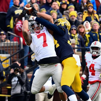 Ohio State's Jalin Marshall reaches over Michigan safety