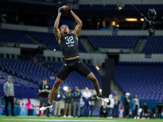 Clemson defensive back A J Terrell runs a drill at the NFL football scouting combine in Indianapolis, Sunday, March 1, 2020. (AP Photo/Michael Conroy)