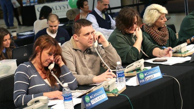 The annual Catalyst Rehab Telethon will be held 11 a.m. to 8 p.m. Feb. 3 Center Court in the Richland Mall in Ontario. Volunteers answer the phones during a past telethon in this News Journal file photo.