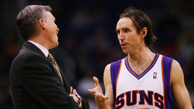 Phoenix Suns Head Coach Mike D'Antoni talks with Steve Nash during a game against the New Jersey Nets Friday, Nov. 25, 2005 in Phoenix.
