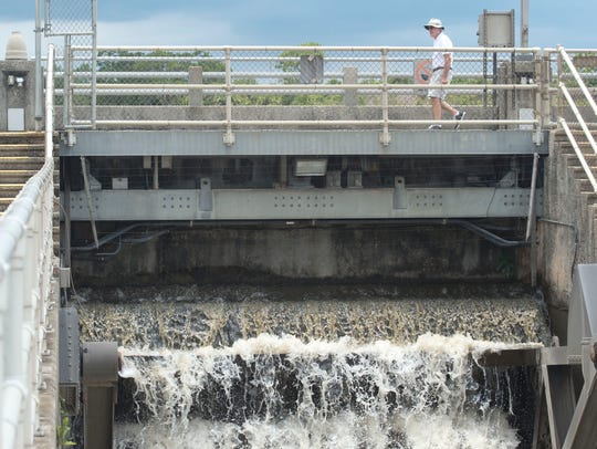 Water from Lake Okeechobee pours through the St. Lucie