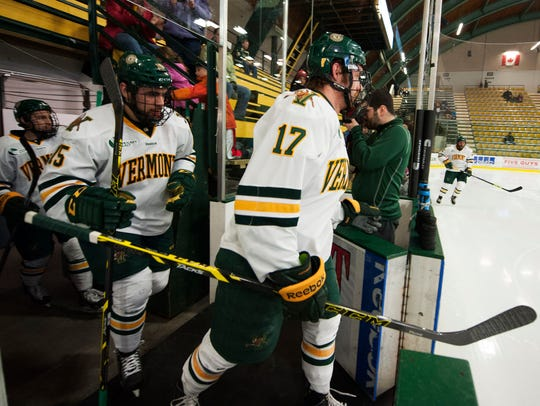 Catamounts forward Jake Fallon (17) takes the ice for