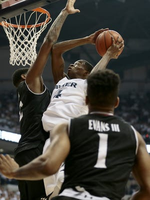 Xavier Musketeers guard Edmond Sumner (4) shoots a layup in the first half of the 83rd annual Crosstown Shootout NCAA basketball game between the Xavier Musketeers and the Cincinnati Bearcats at the Cintas Center in Cincinnati Saturday, Dec. 12, 2015. At the half, Xavier led 42-26.