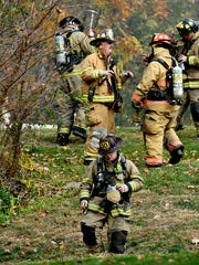 Fire crews and hazmat response team work to contain a propane tank fire after it went over a guard rail on South Lake Road in Jackson Township, Tuesday, Nov. 15, 2016. Dawn J. Sagert photo