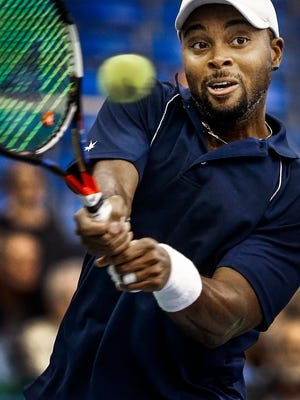 Donald Young hits a return shot during his 7-6 (7), 6-3 victory over Reilly Opelka in the second round of the Memphis Open.