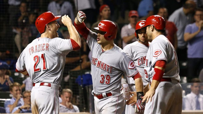 Cincinnati Reds' Devin Mesoraco (39) celebrates his grand slam off Chicago Cubs relief pitcher Hector Rondon with Todd Frazier (21) Joey Votto, right, and Billy Hamilton, during the ninth inning of a baseball game Monday, June 23, 2014, in Chicago. All four scored on the play.