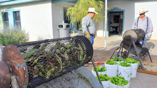 Luna County 4-H volunteers roll the fird drum to rast green chile during the 2015 great American Duck Race in Deming. 4-H members will be at it again, salleing Luna County's finest green chile Aug. 27-28 at this year's event.