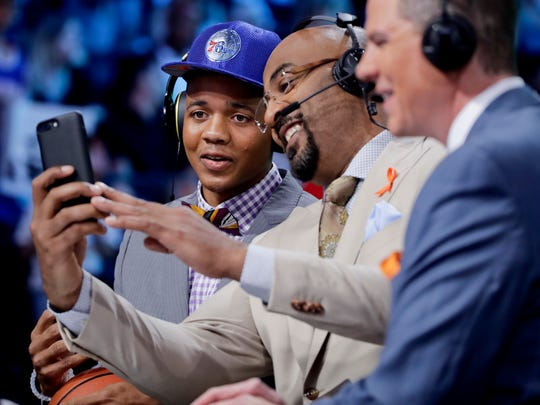 Washington's Markelle Fultz smiles for a selfie with Dennis Scott, of NBATV, after being picked first overall in the NBA Draft on Thursday.