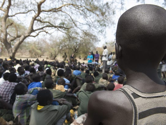 Young boys attend a ceremony of the child soldiers