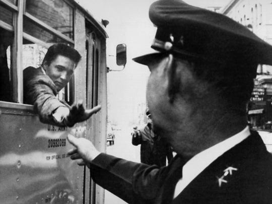 Elvis Presley on the day of his induction into the U.S. Army on March 24, 1958. He is shown leaving Downtown Memphis on the bus that will take him to Kennedy Veterans Hospital.