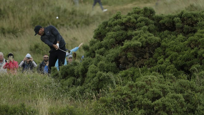 Brooks Koepka of the United States plays a shot to the 17th green during the first round of the British Open Golf Championships Thursday at Royal Portrush in Northern Ireland.
