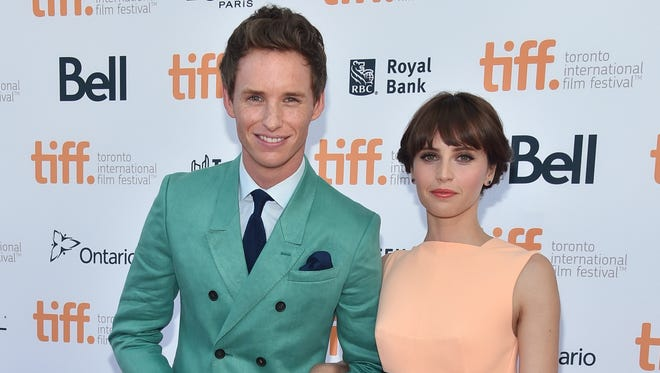 Eddie Redmayne and Felicity Jones attend 'The Theory Of Everything' premiere during the 2014 Toronto International Film Festival.