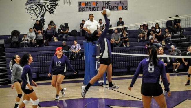Senior Katelyn Yuzos blocks for Mescalero against Ruidoso jv Thursday in Mescalero.