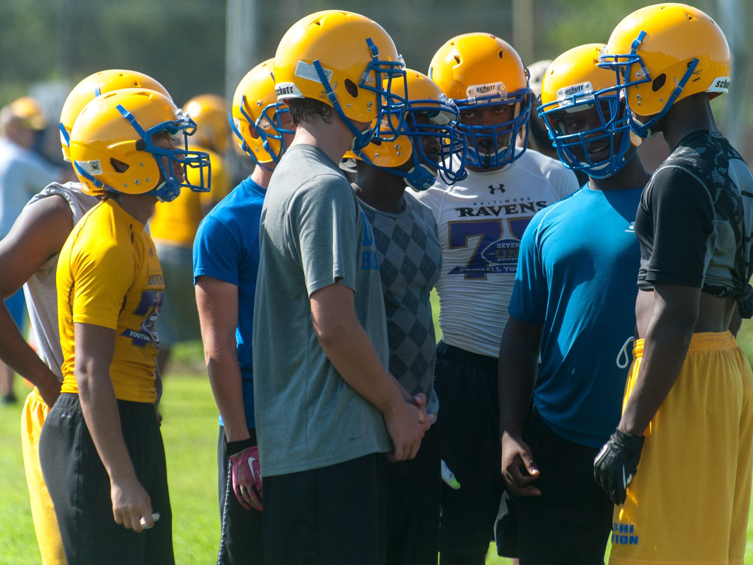 Wicomico High's defense devises the proper play.