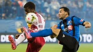 Montreal's Dilly Duka, right, and the Red Bulls' Marius Obekop battle for the ball during the first half of a CONCACAF Champions League  game on Wednesday. (AP Photo/The Canadian Press, Graham Hughes)
