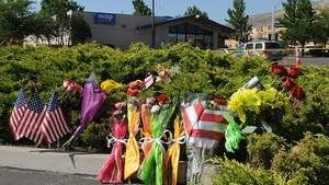 Flowers are placed near the IHOP restaurant in Carson City Wednesday Sept. 7, 2011 the site of Tuesday's massacre where 11 people were shot.