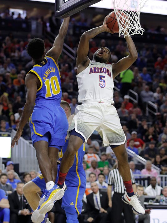 Arizona's Kadeem Allen shoots next to UCLA's Bryce Alford during the first half of an NCAA college basketball game in the semifinals of the Pac-12 men's tournament Friday, March 10, 2017, in Las Vegas. (AP Photo/John Locher)