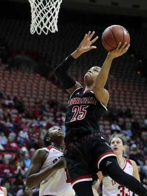 Louisville's Asia Durr goes up for two.
