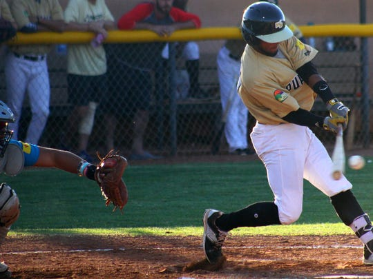 White Sands shortstop Brandon Torres makes contact with a pitch on Monday.