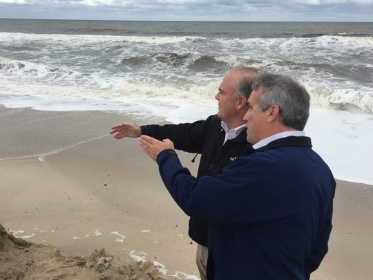 DEP Commissioner Bob Martin (left) and Bill Dixon, manager of DEP's Bureau of Coastal Engineering, assess storm damage in Normandy Beach.