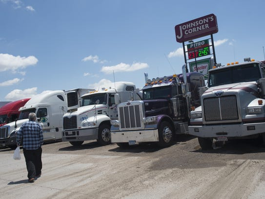 Truck drivers park at Johnson's Corner truck stop in