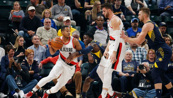 Portland Trail Blazers guard C.J. McCollum (3) drives to against Indiana Pacers guard Victor Oladipo (4) at Bankers Life Fieldhouse.
