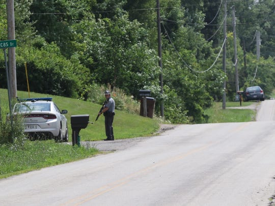 A state trooper guards the perimter at Lucas Drive and Washington-North Road on Wednesday afternoon.