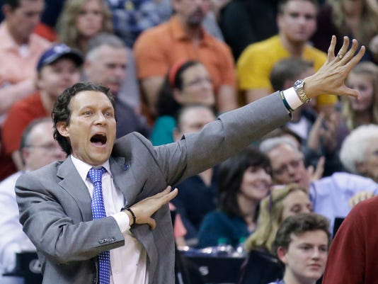 FILE - In this Dec. 11, 2015, file photo, Utah Jazz coach Quin Snyder shouts to his team during the team's NBA basketball game against the Oklahoma City Thunder in Salt Lake City. The Jazz are in position to make the playoffs for the first time since 2011-12 and finish above .500 for the first time since 2012-13. This would be the first time most of the roster and second-year coach Snyder as been in the playoffs. (AP Photo/Rick Bowmer, File)