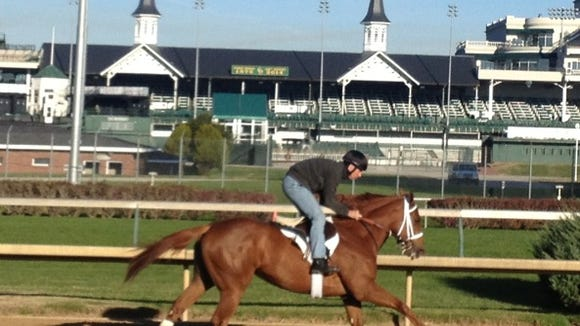 I'm a Looker, with exercise rider Mark Cutler up, training at Churchill Downs.