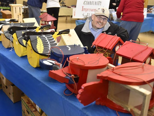 Paul Pflughoeft of Algoma sells handcrafted bird houses in different designs in the vendor area.