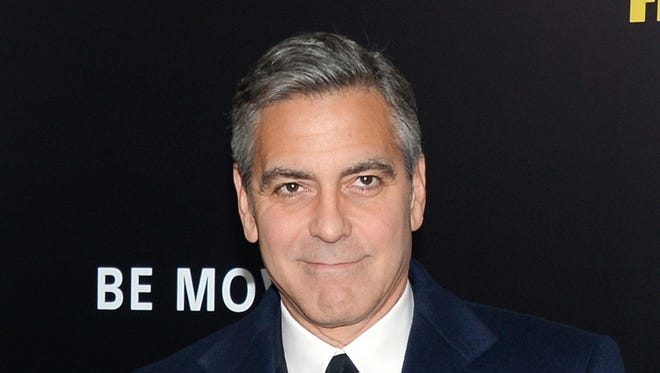"""George Clooney attends the premiere of """"The Monuments Men."""""""